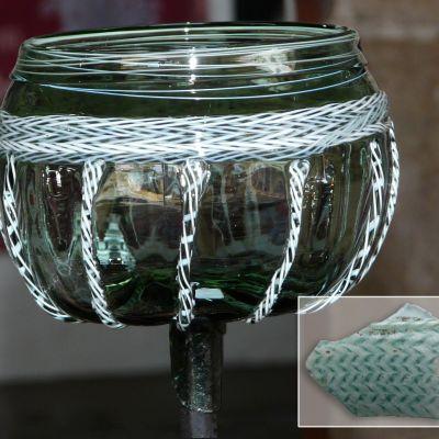 Paule, reconstitution d'une coupe en verre à partir d'un fragment trouve pendant la fouille.Cliché J. Le Gall de l'enceinte de Brécilien. DessinChristian Jegou